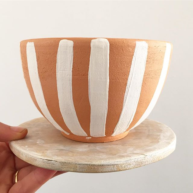 Small(ish) terracotta bowl with white stripes.  #australianpottery #southcoastnsw #australianceramics #begavalleypotters #sapphirecoastnsw