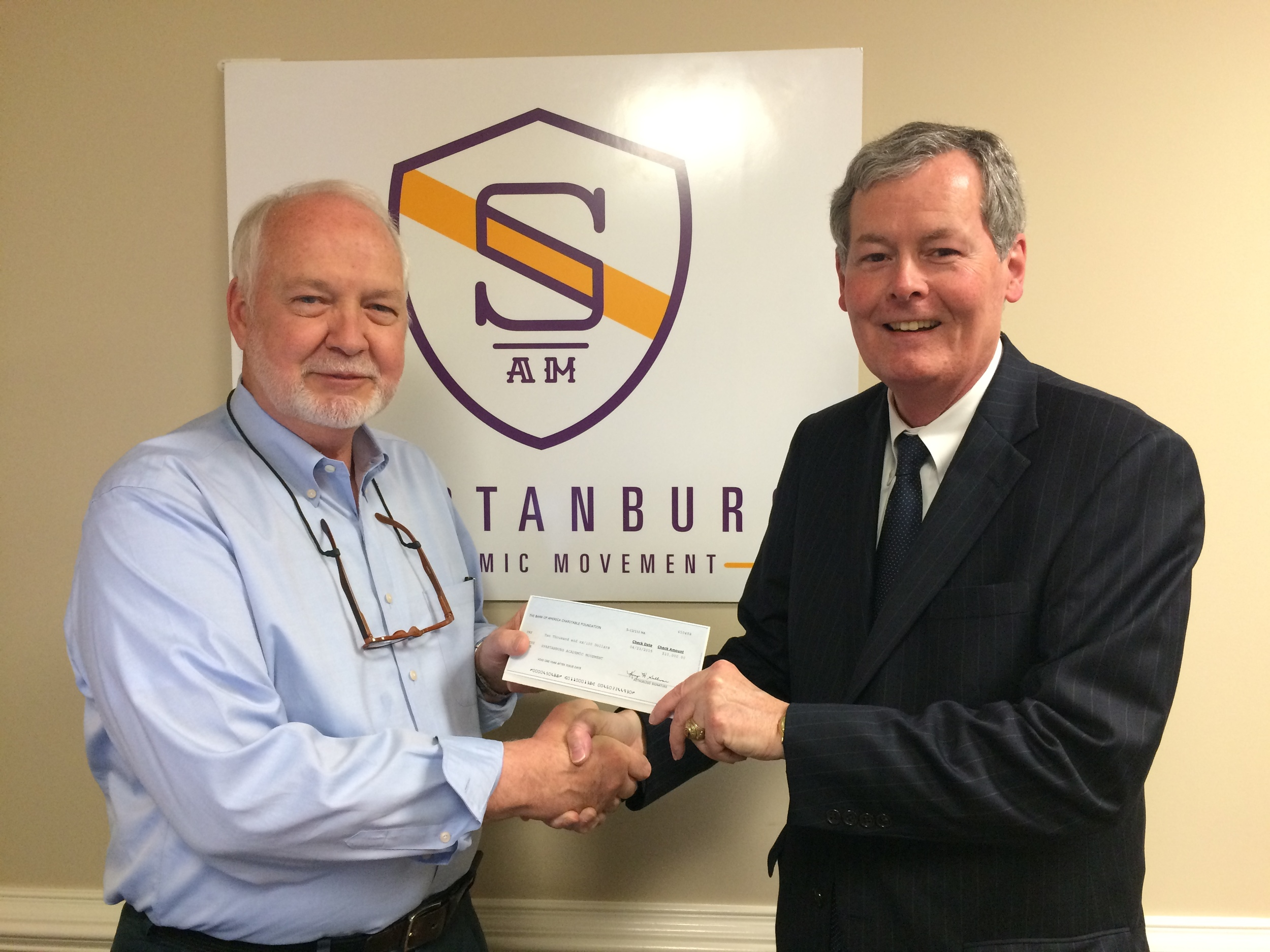 Spartanburg Market President Scott Mitchell of Bank of America (right) presented the $10,000 check to SAM's Executive Director (left) at the SAM office.