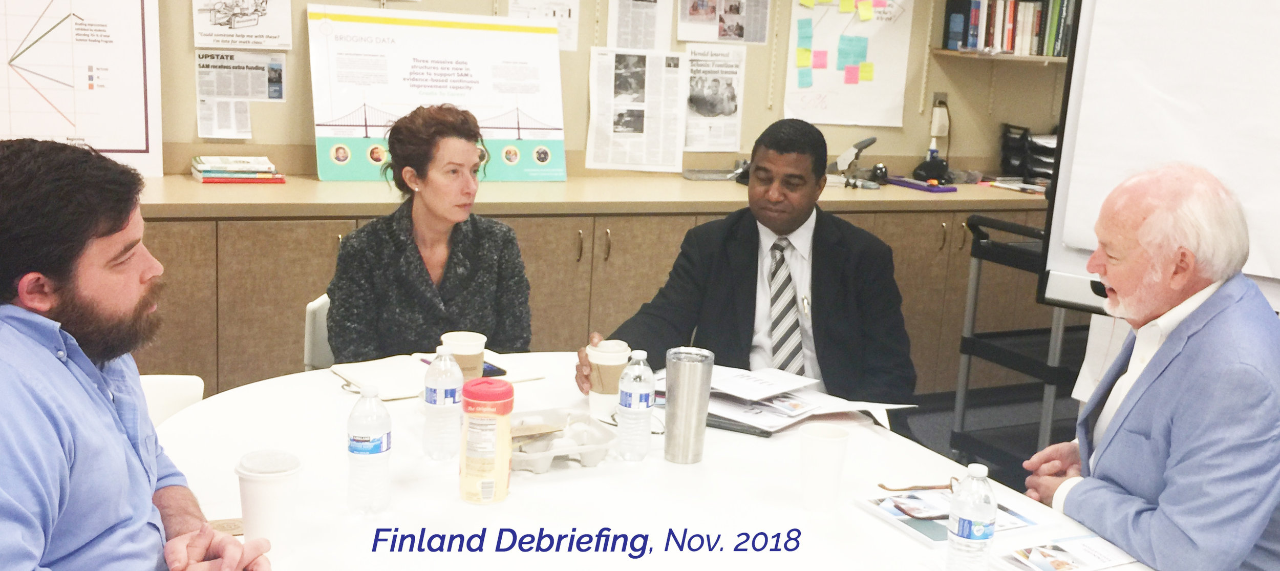 Spartanburg Educational leaders Drs. Laura Reynolds, Russell Booker, and John Stockwell provide insights to Spartanburg Herald Journal reporter Adam Orr (left) after they participated in a trip to explore the Finnish Educational System.