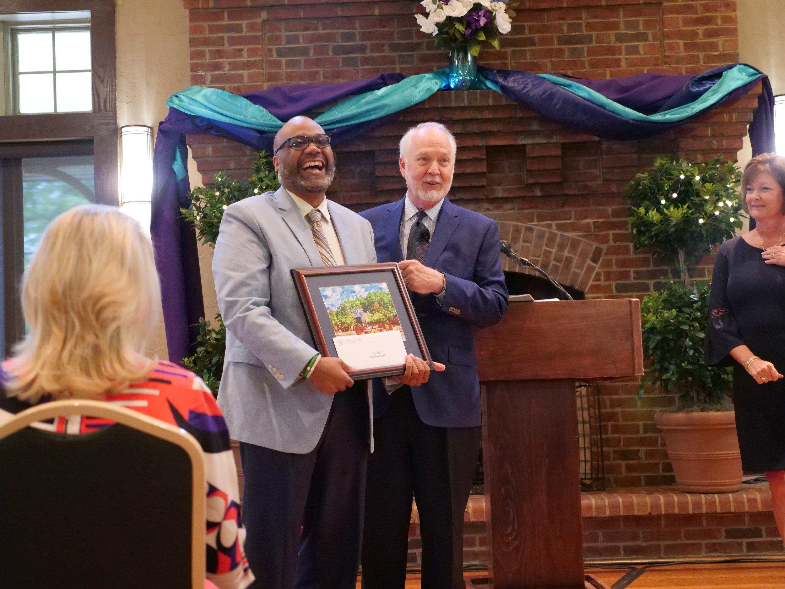 Keith Burton, Principal receives the Wardlaw Pioneer Award for Lone Oak Elementary School, an award which included $5,000, in recognition Continuous Improvement work at the District 6 School.