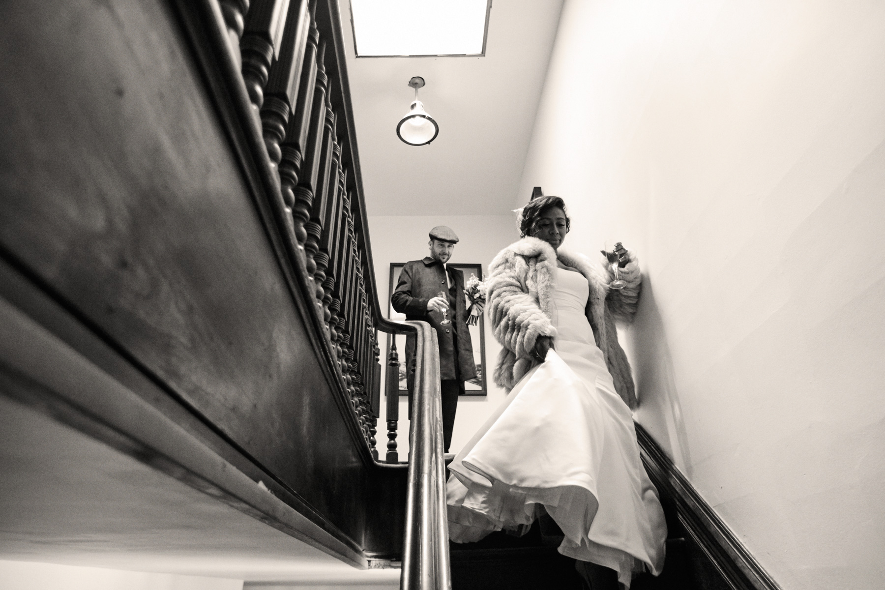Descending the staircase from the Top Hat and Bowler suites.