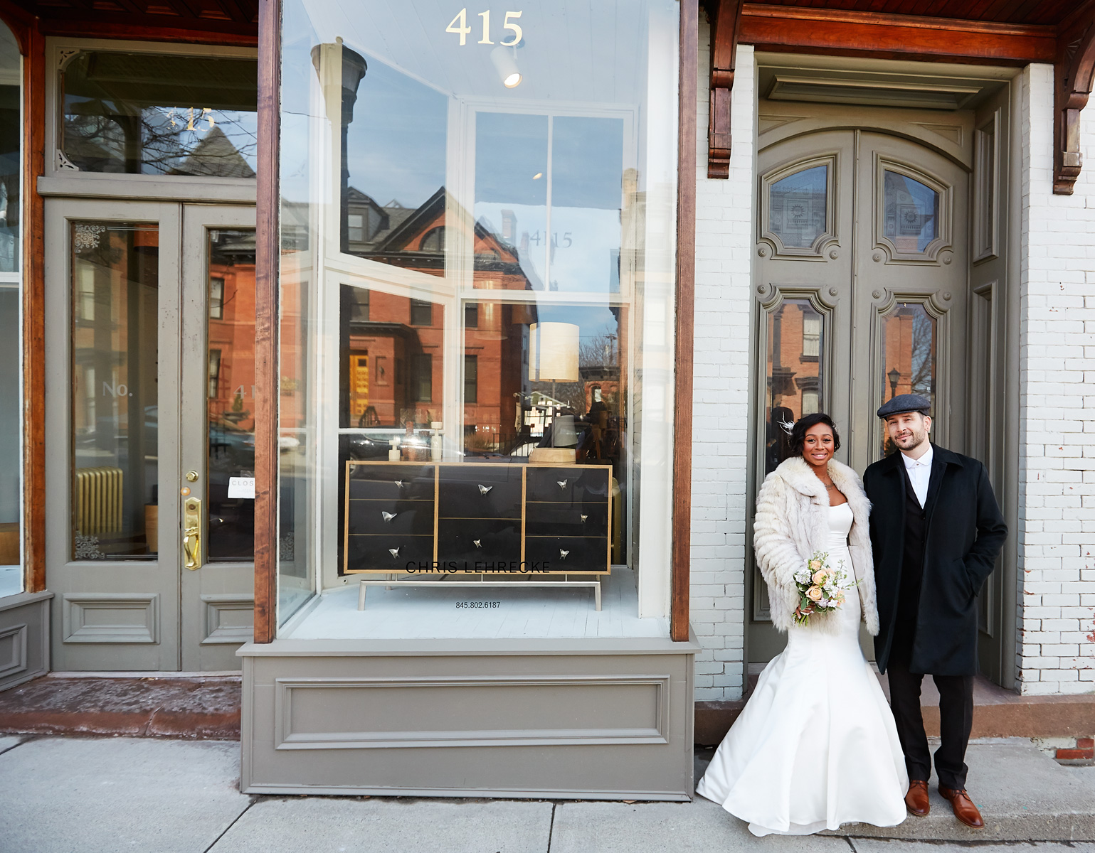 The newlyweds in the doorway of the Hudson Milliner.