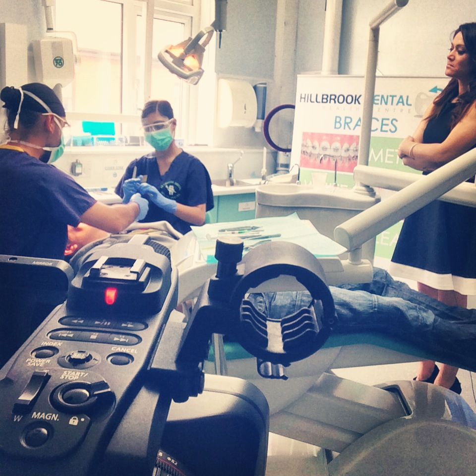 Dr Pardip Atthi demonstrating the application of braces