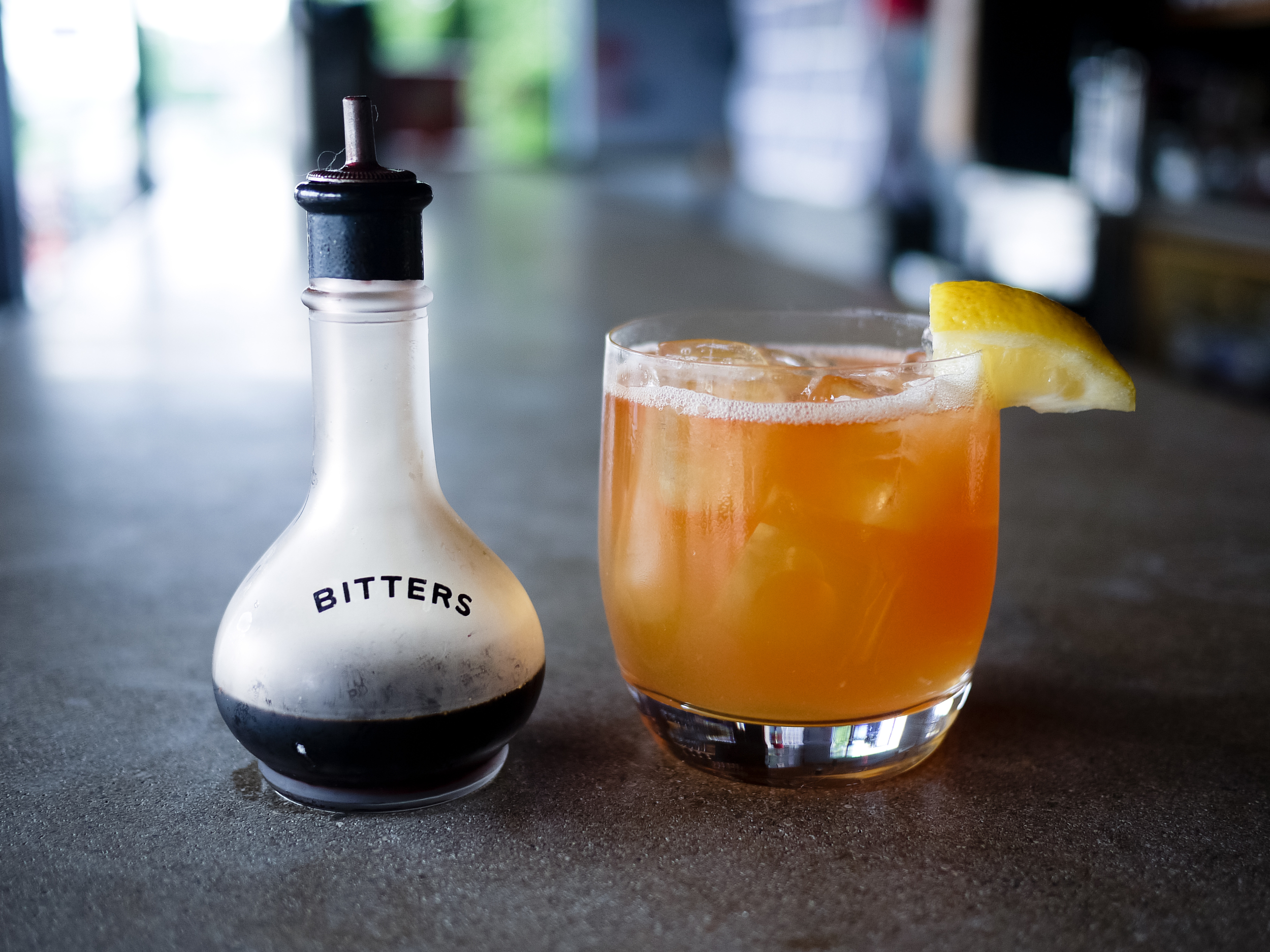 House-made aromatic bitters and a Cardinal Sling cocktail.