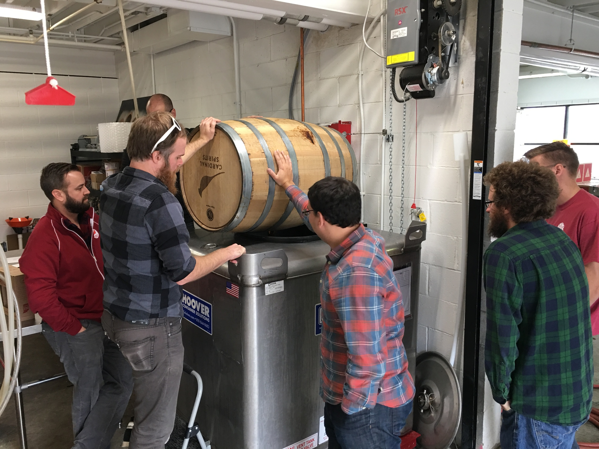 Emptying the whiskey barrel into the tank in preparation for bottling.