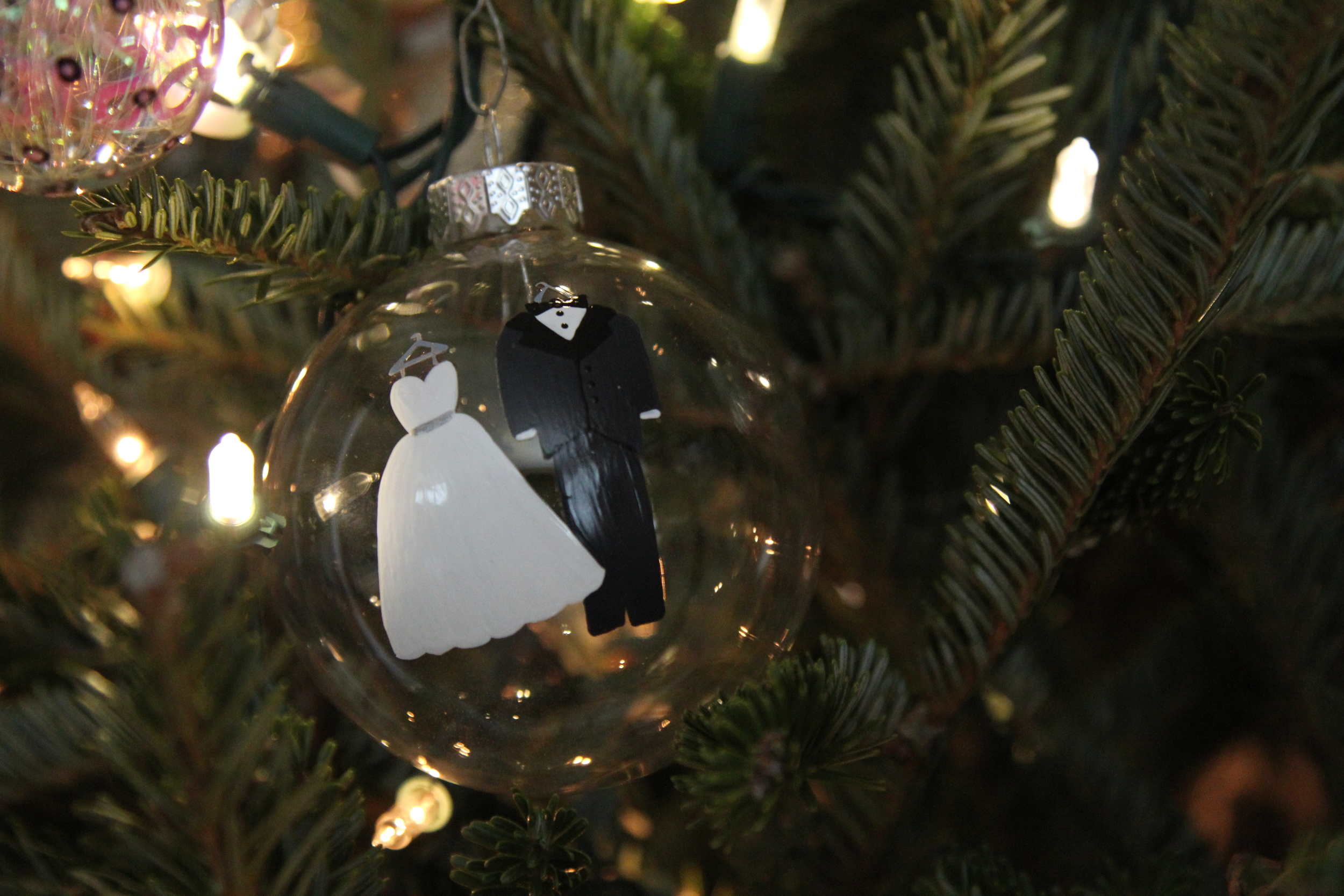 I ordered this ornament from THE CURIOUS CRAB on Etsy. I sent her a picture of my wedding dress and Jason's tux and she created an ornament that looked just like our wedding day attire! Check out this Etsy shop  here .