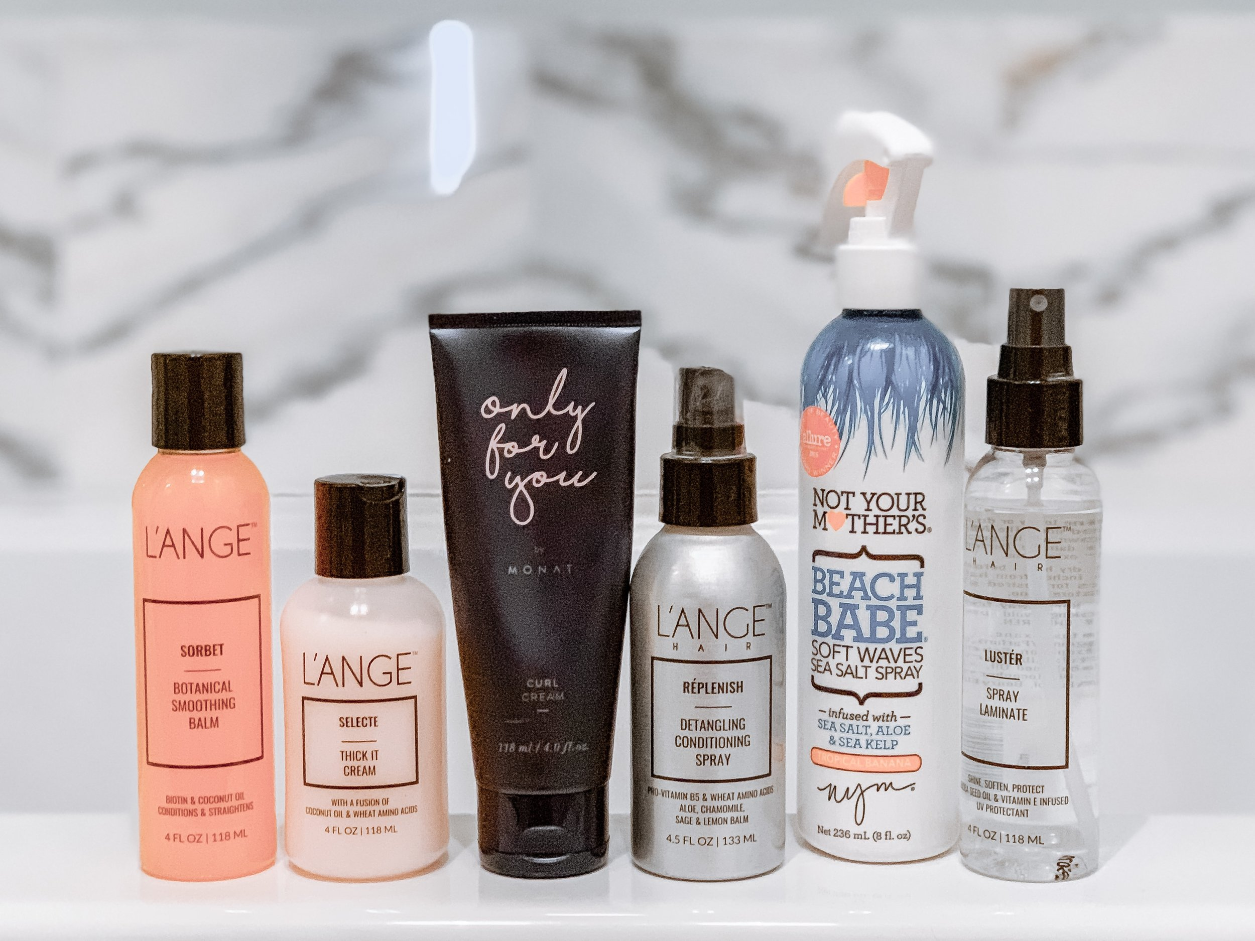 L'Ange Sorbet ,  L'Ange Thick It Cream ,  Monat Curl Defining Cream ,  L'Ange Conditioning Spray ,  Not Your Mother's Sea Salt Spray , &  L'Ange Spray Laminate