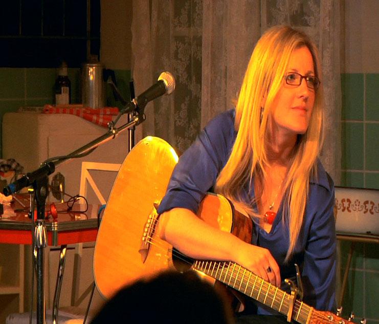 leaning-on-guitar.jpg