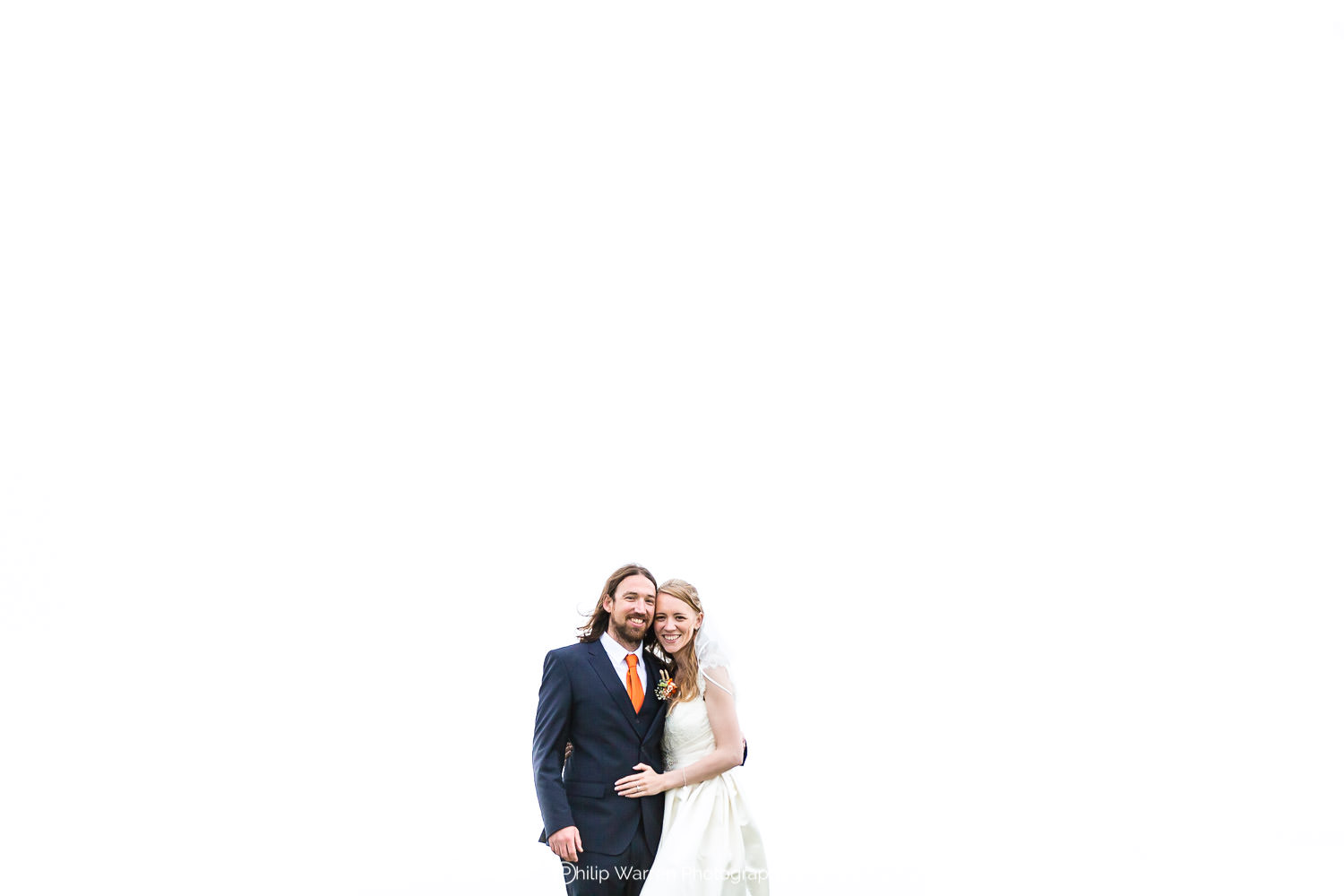 bride and groom holding each other with white background