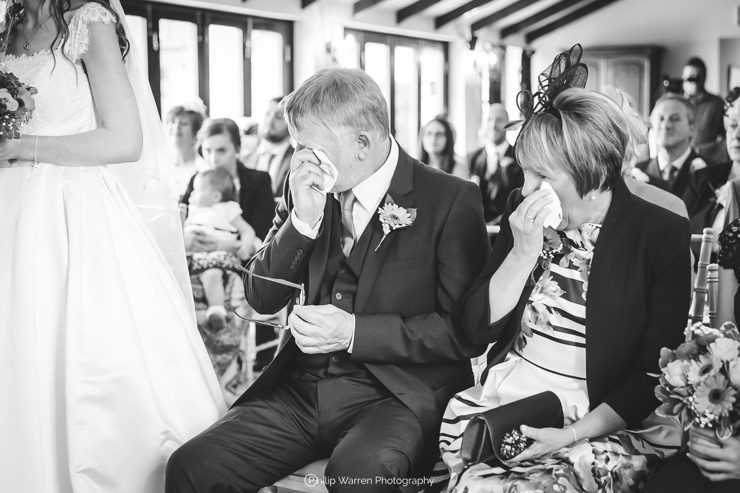 mother and father of the bride crying