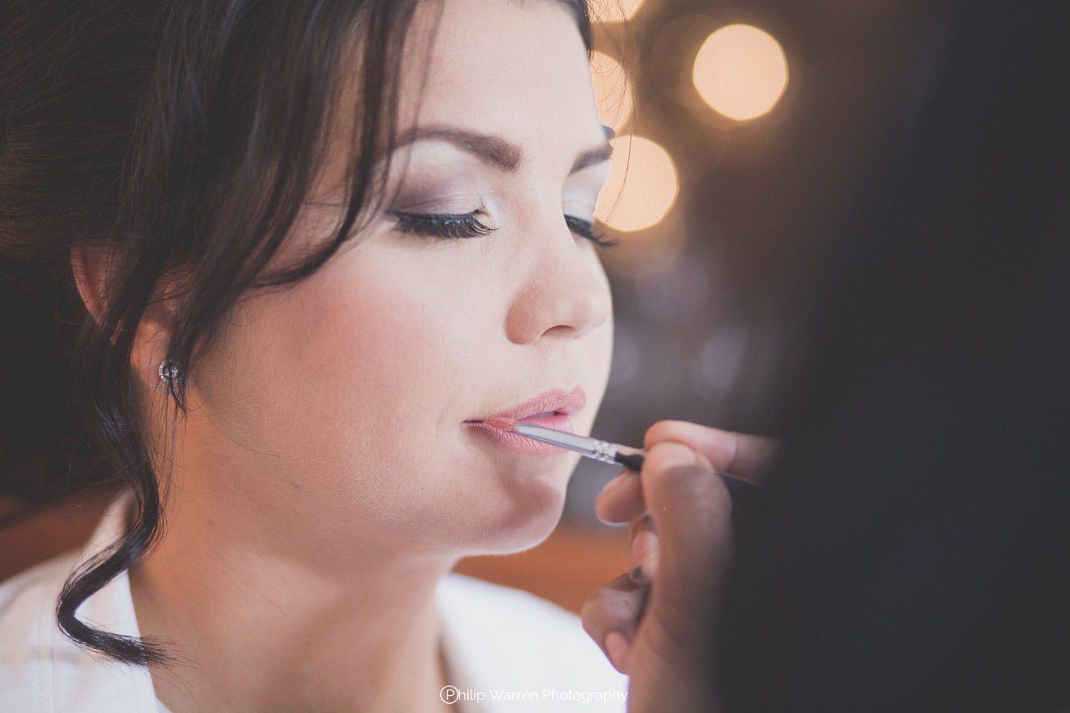 bride having makeup