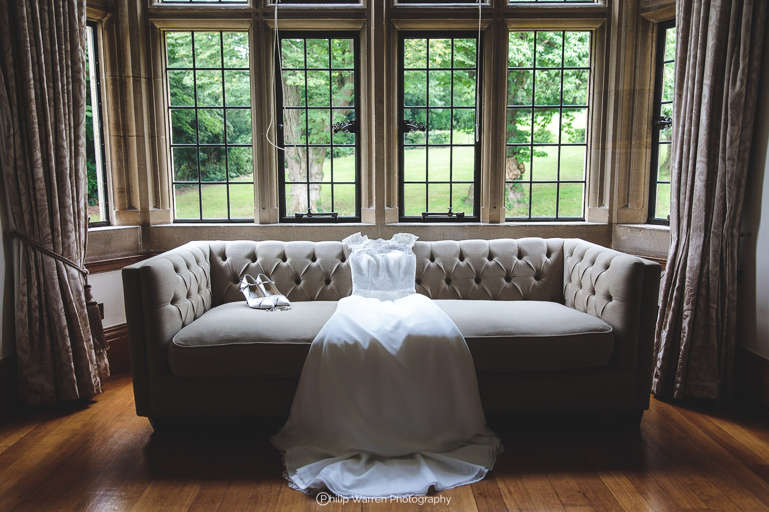 wedding dress laid out on settee