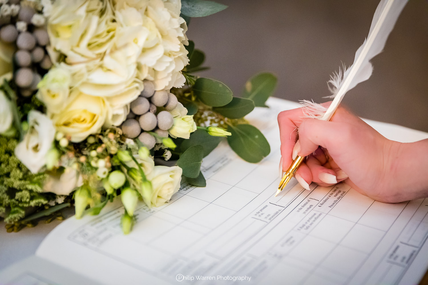 signing the register with flowers