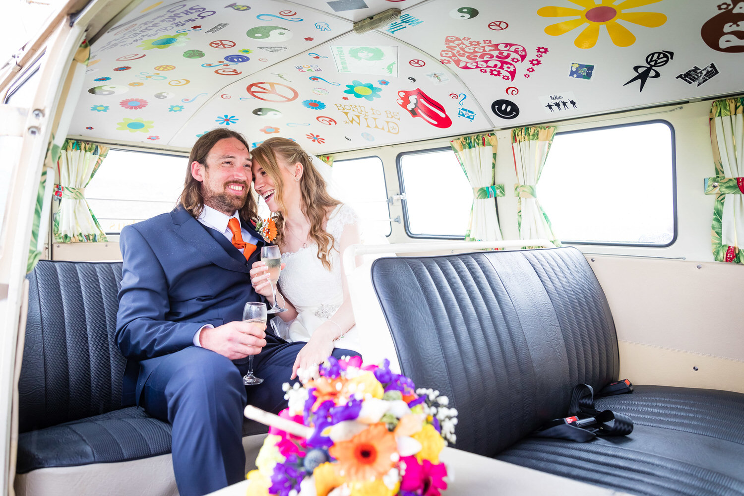 bride and groom sat inside vw camper van