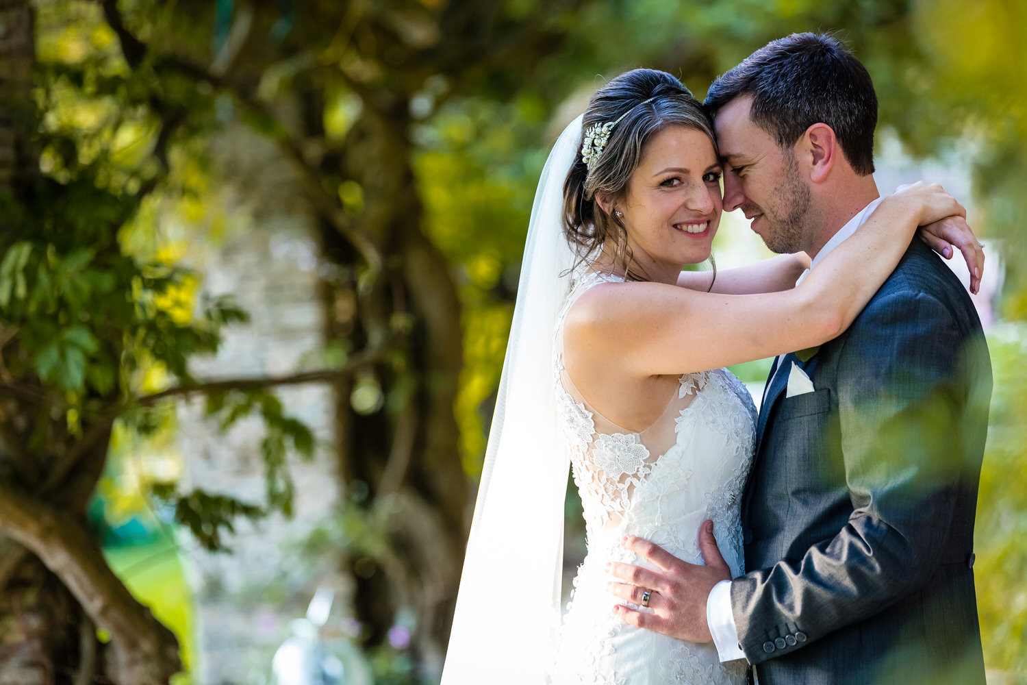 bride and groom embrace at glenfall house cheltenham