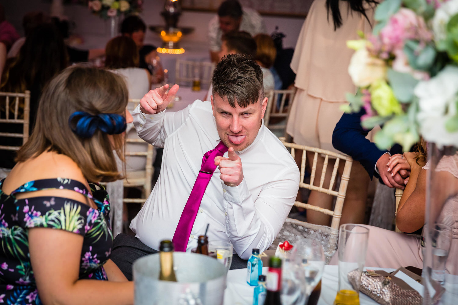 wedding guest at party pointing at camera