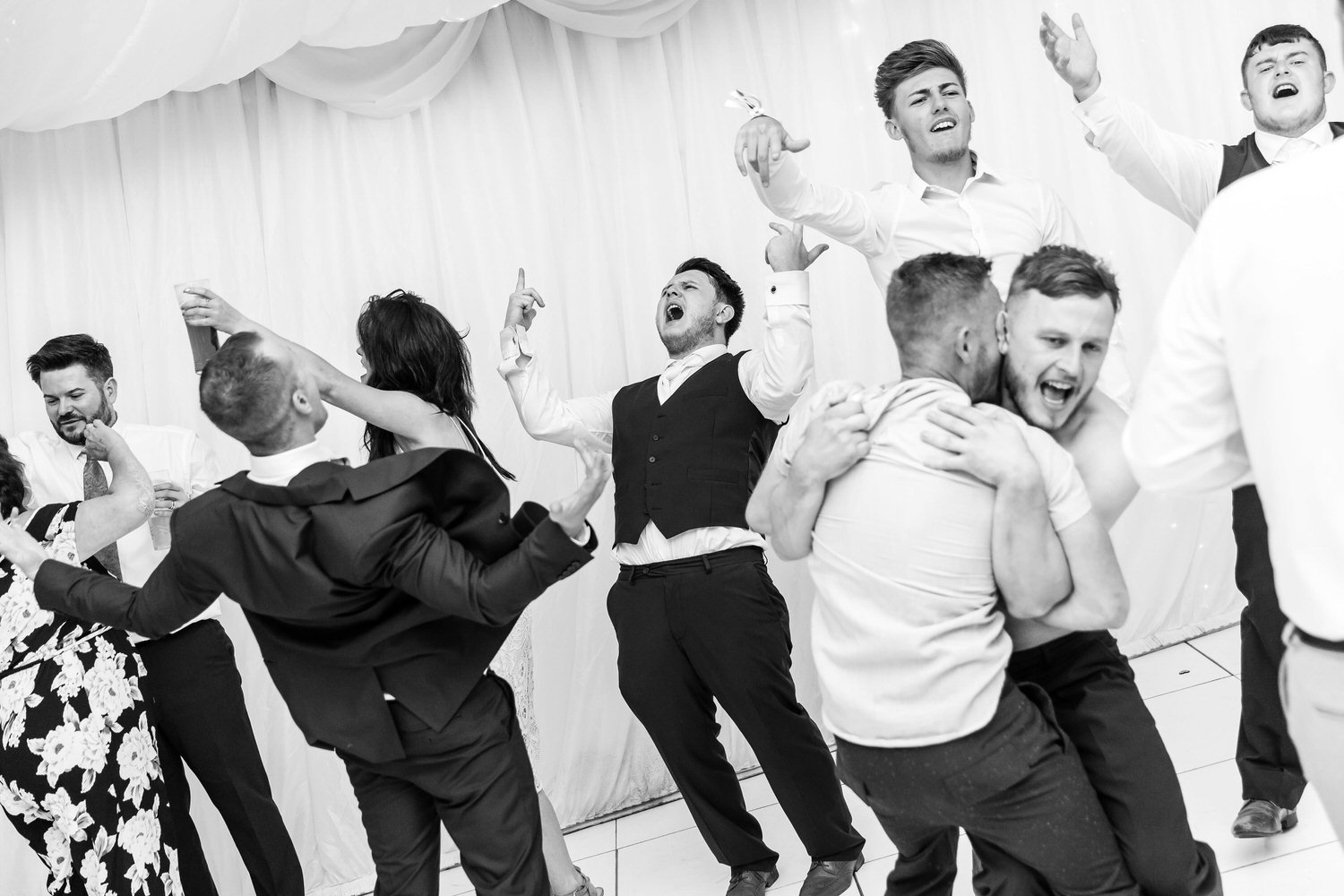 dancefloor party at lakeside venue wedding