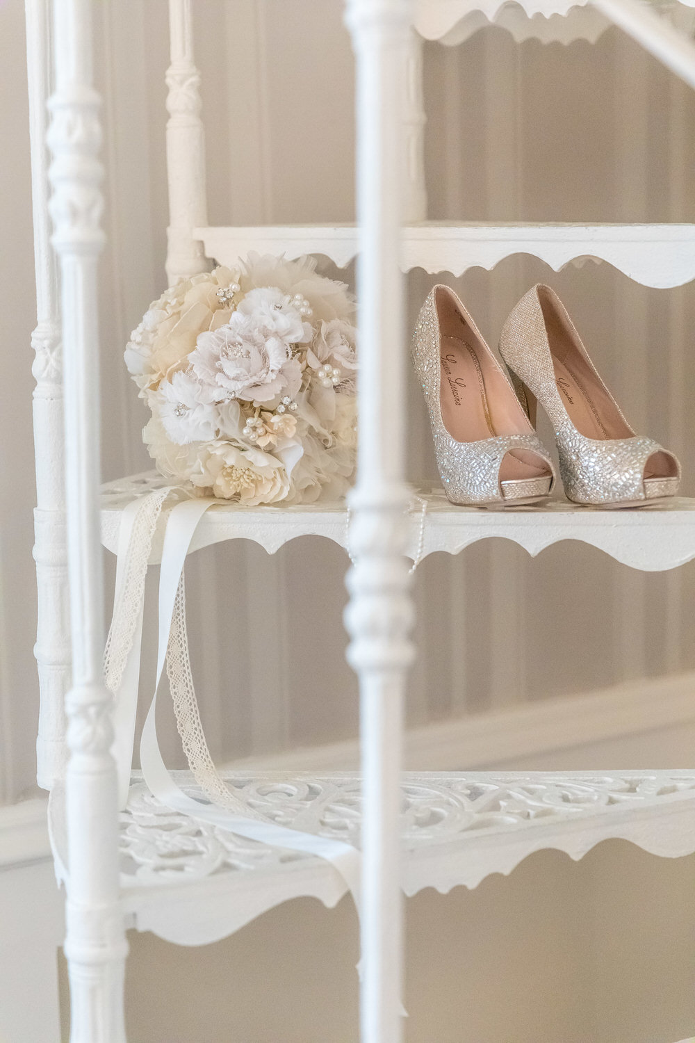wedding shoes and bouquet on stairs