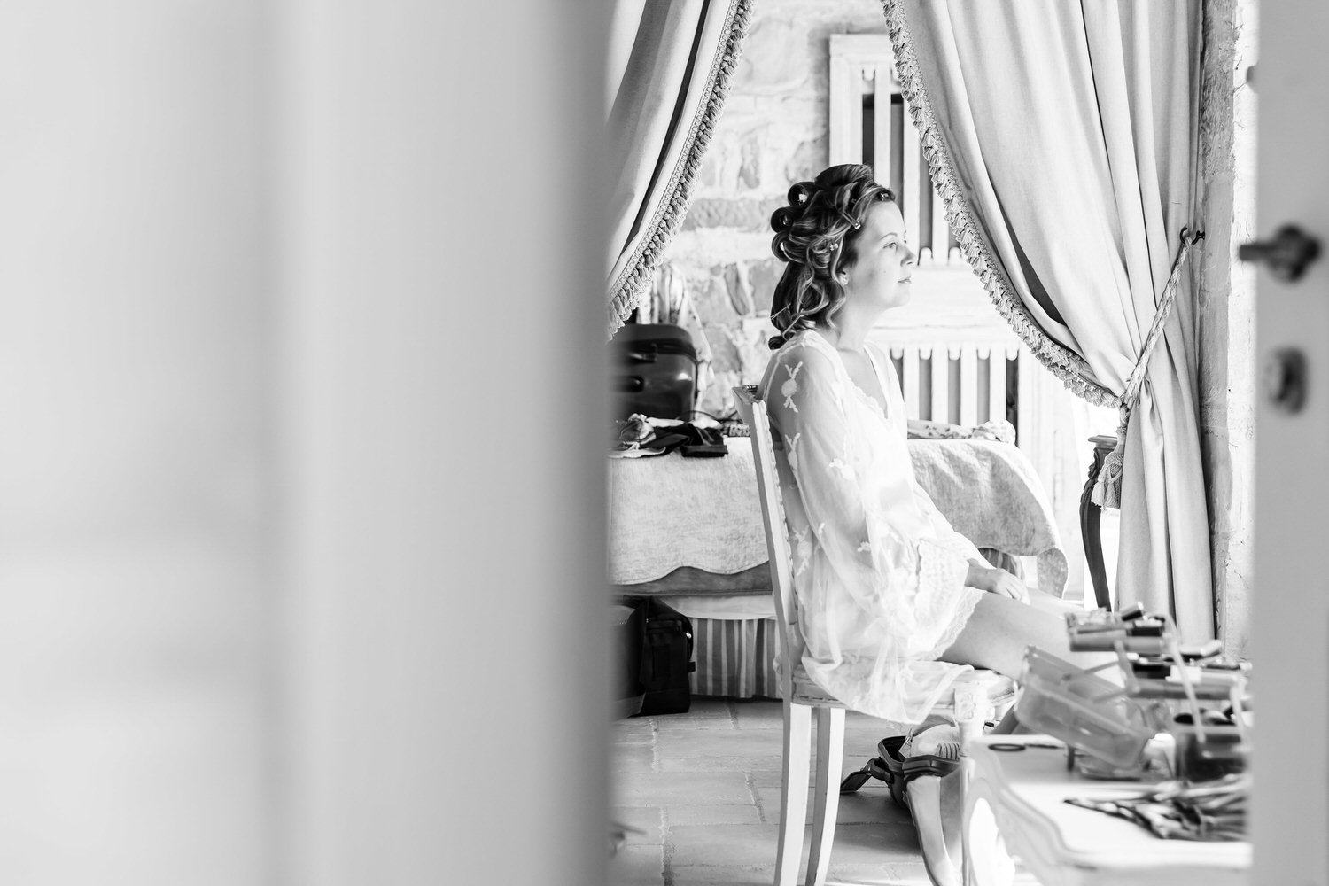 bride having her makeup applied before wedding