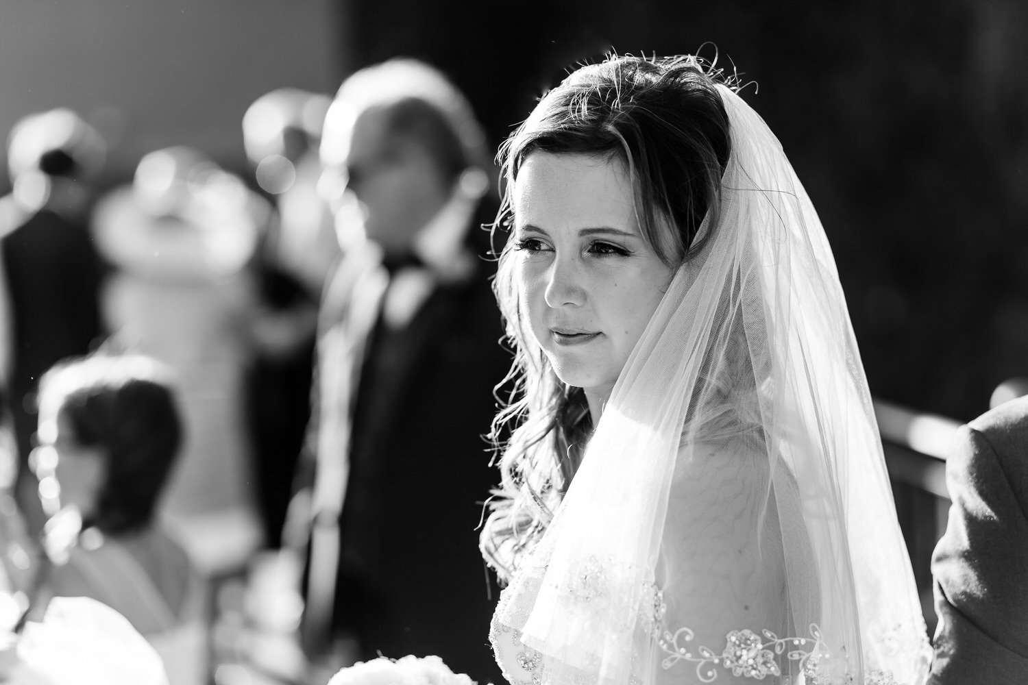 black and white of bride during ceremony in florence