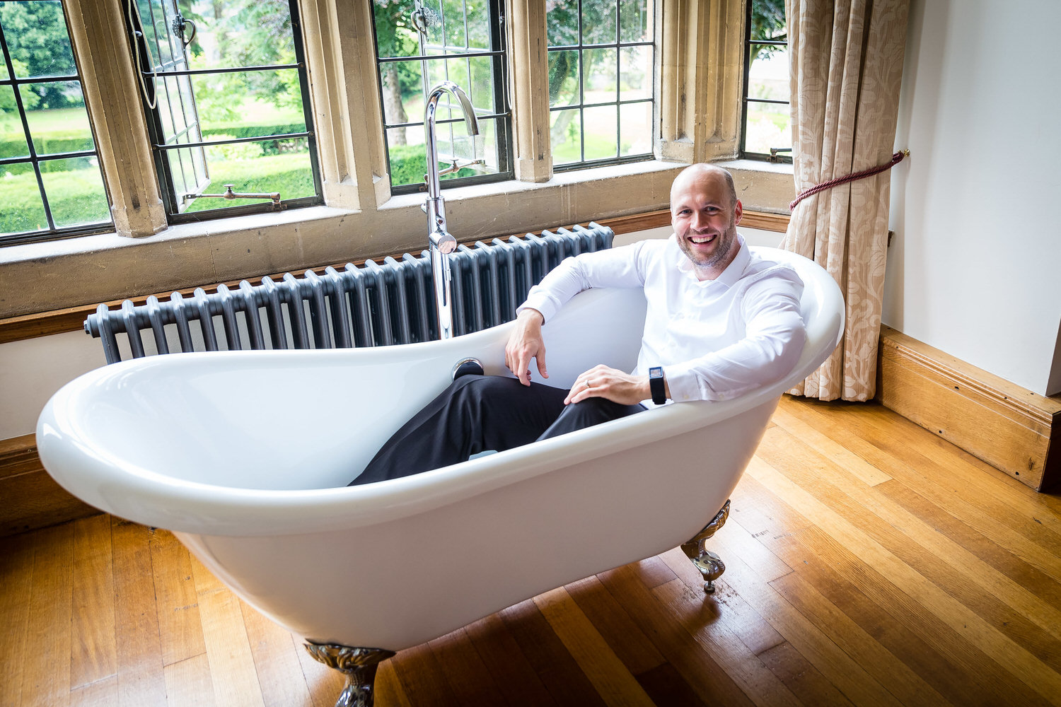 philip warren sat in a bath at coomeb lodge in blagdon
