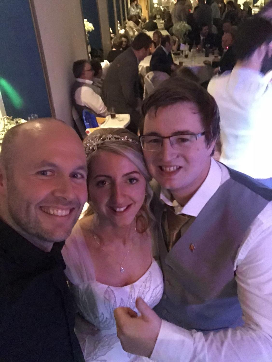 another selfie with the happy couple