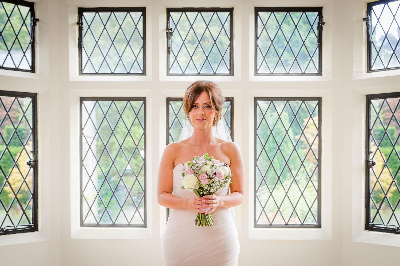 bride holding bouquet at miskin manor hotel wedding