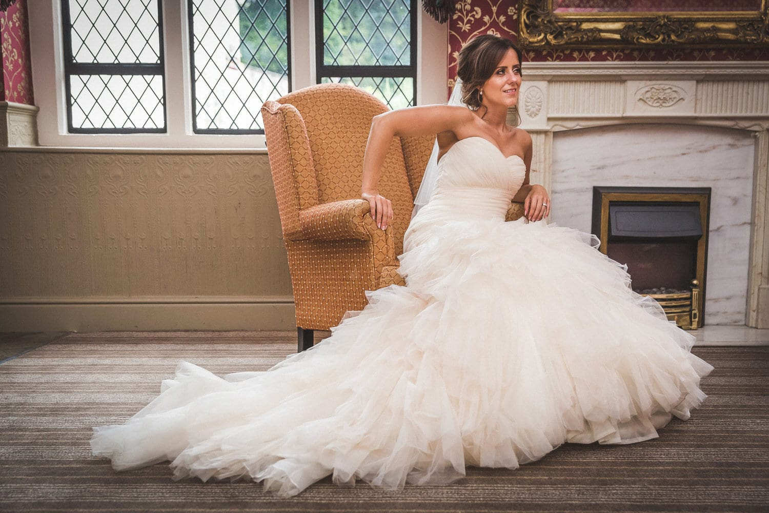 bride sat in chair at miskin manor