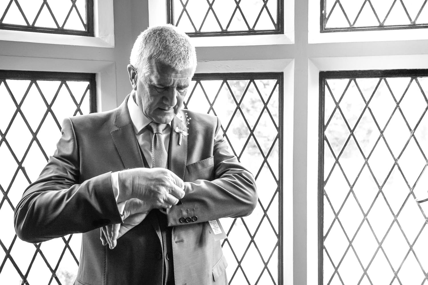 father of the bride doing cufflinks