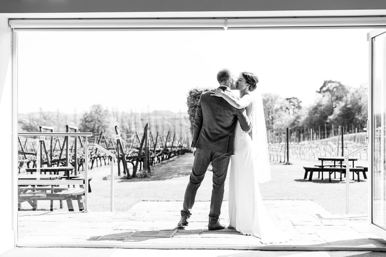 bride and groom kissing at llanerch vineyard