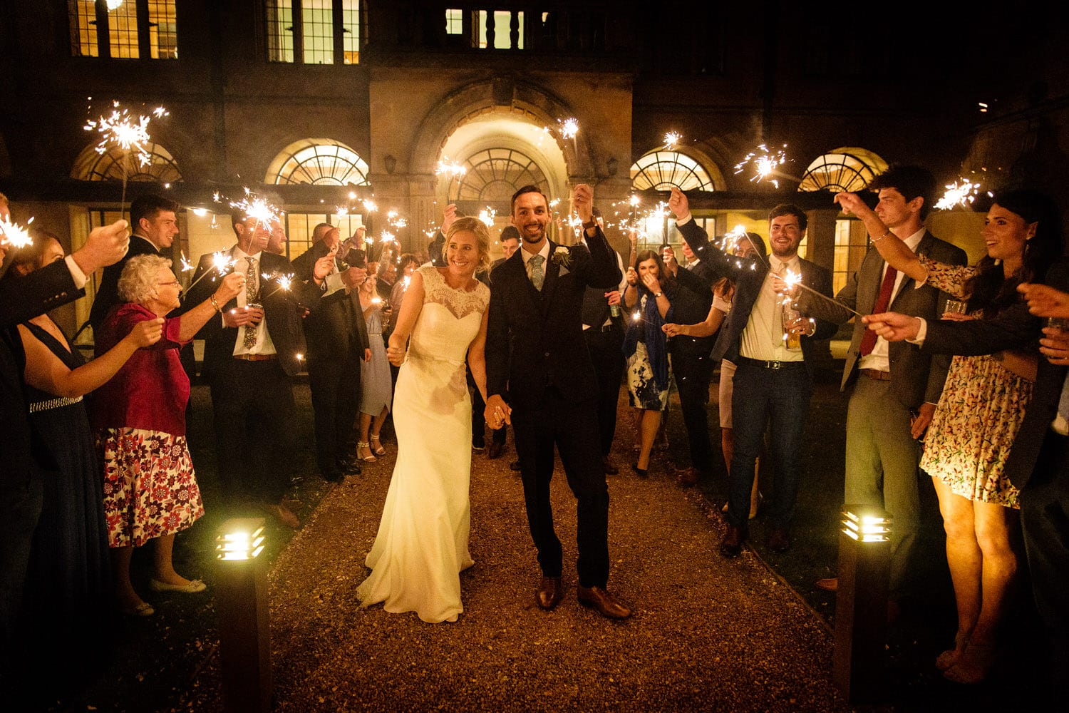 Sparklers in the night of the wedding at Coombe Lodge, Blagdon