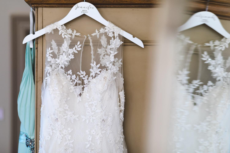 wedding dress hangiing on hanger