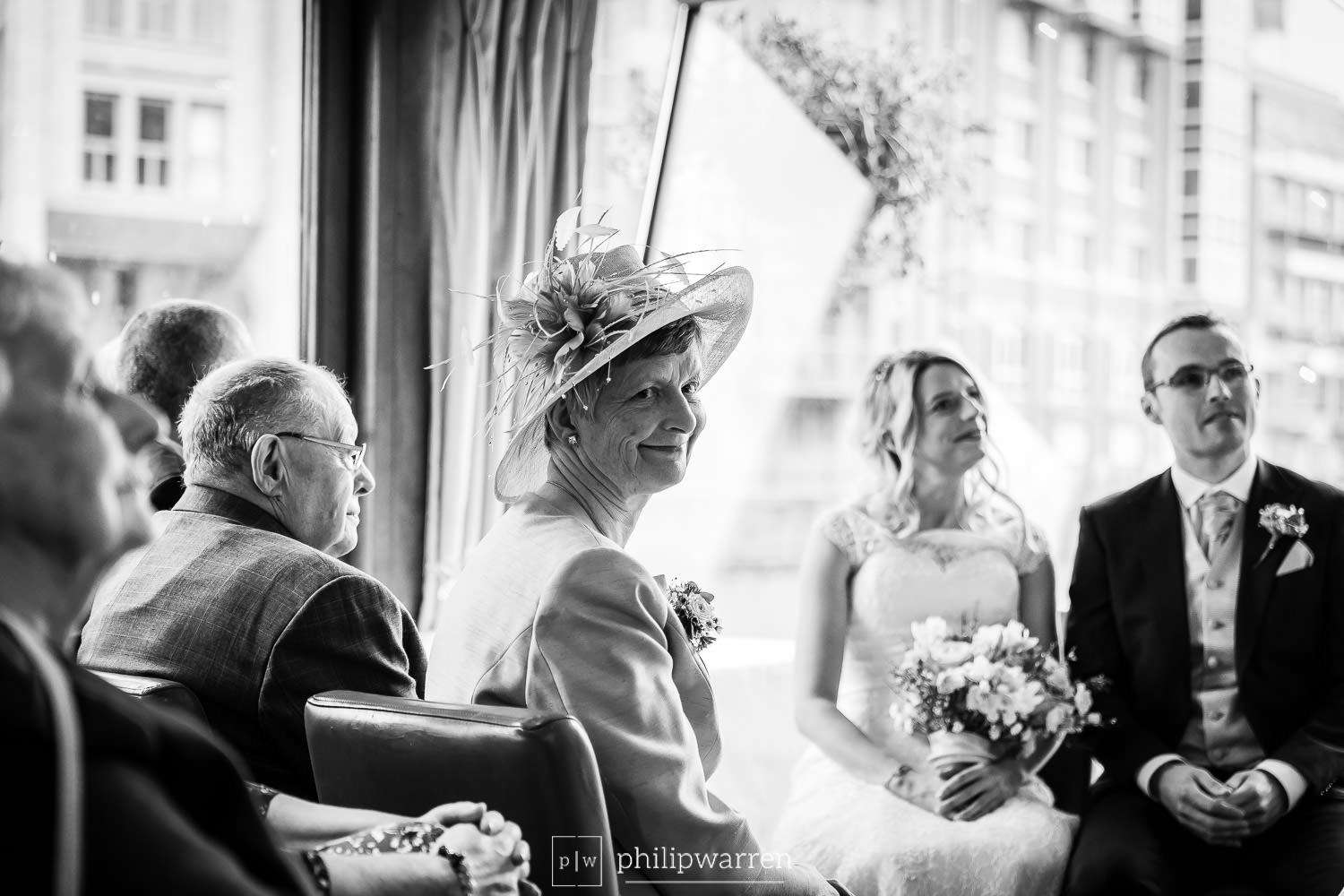 mother of the bride smiling during wedding