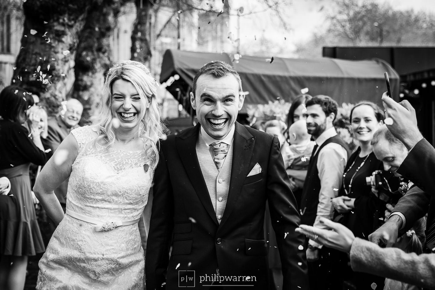 confetting photo of the bride and groom at glassboat brasserie