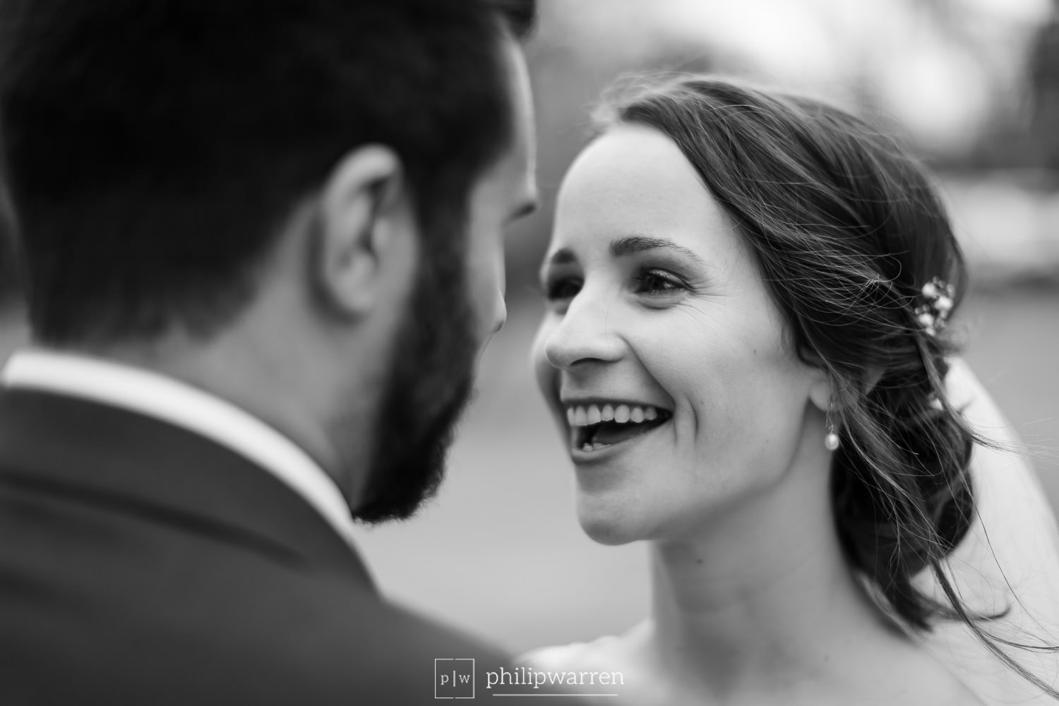 bride smiling at her new busband in black and white