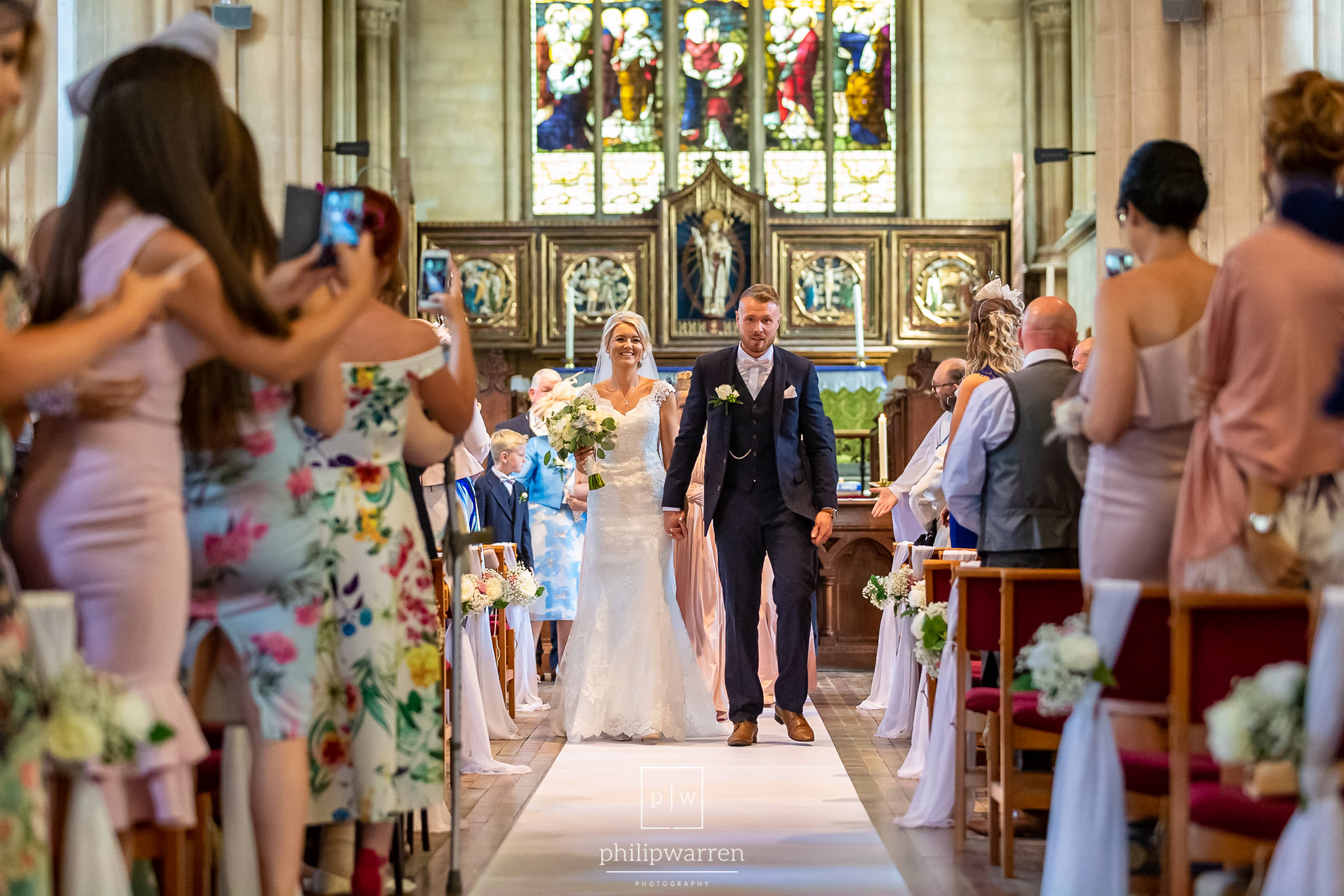 just married in church walking down the aisle