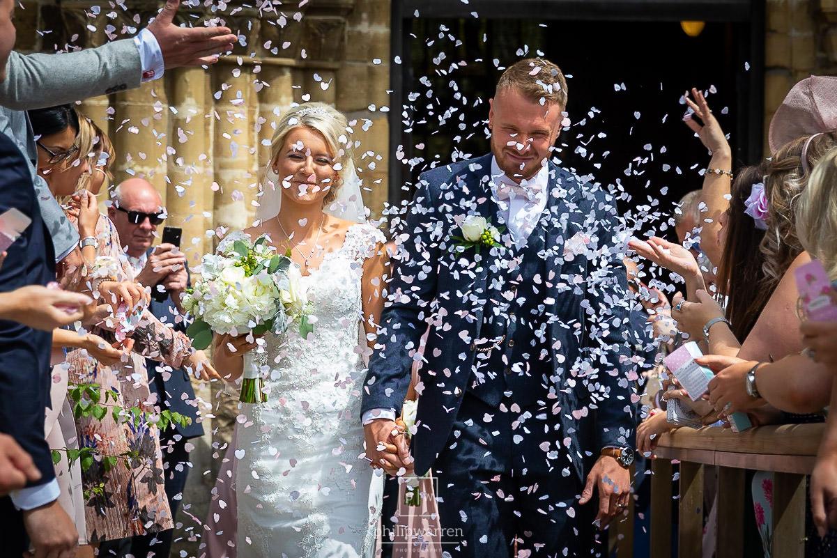 confetti photo of bride and groom outside church