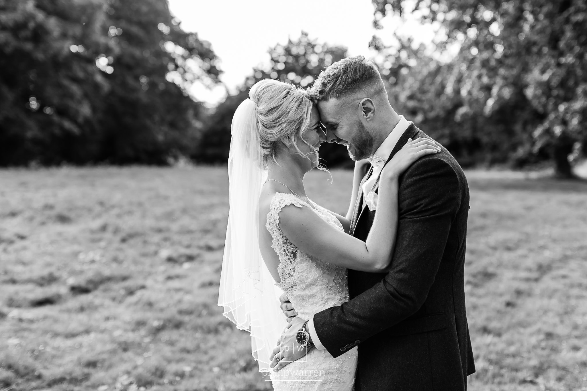 black and white photo of bride and groom holding each other