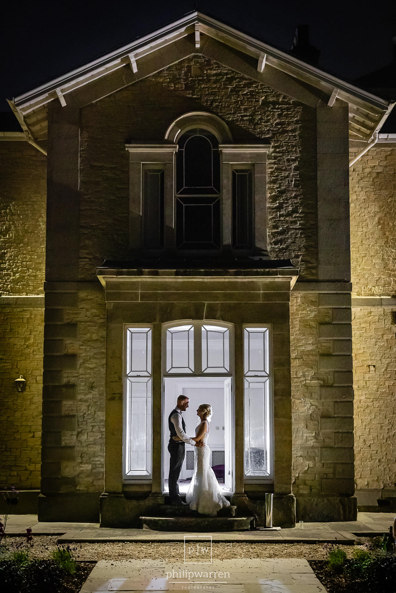 photo of the bride and groom at night in st tewdrics house