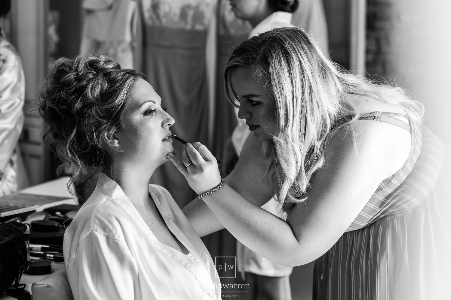 wedding make up being applied to bride