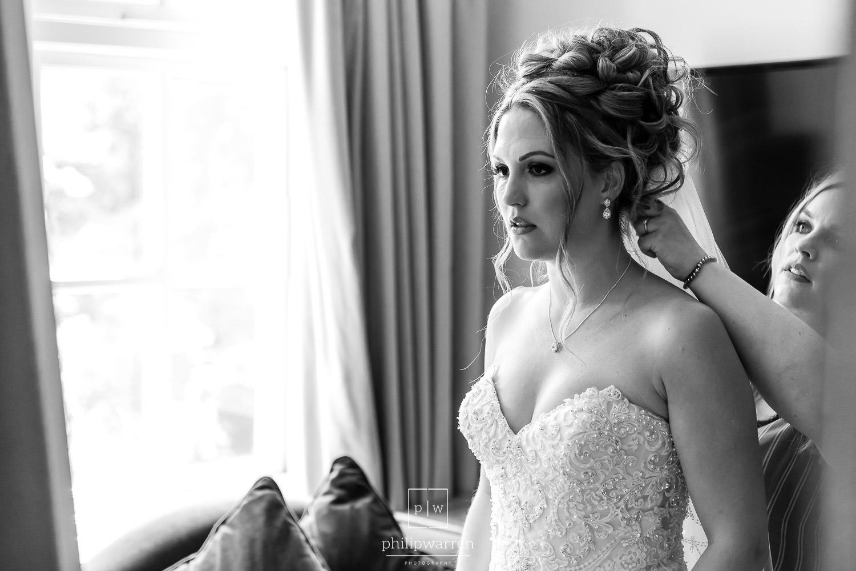 bride having her veil put in before the wedding