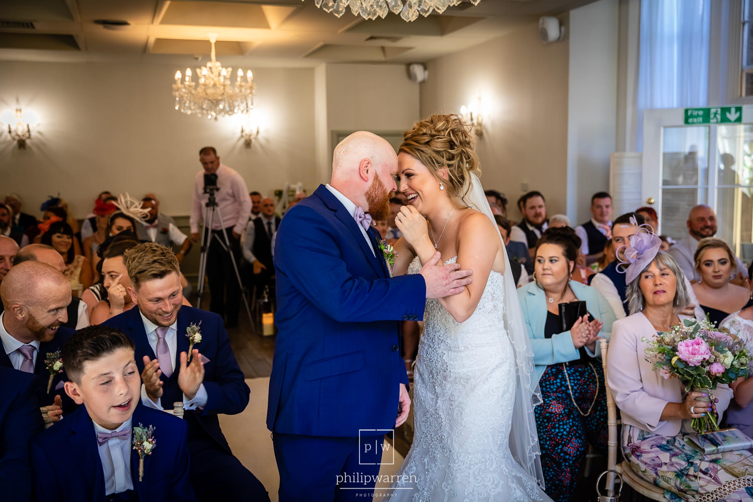 bride and groom laughing to each other during bryngarw house wed