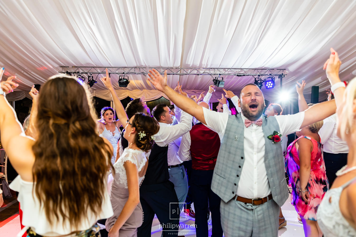 wedding guests dancing to the bands music