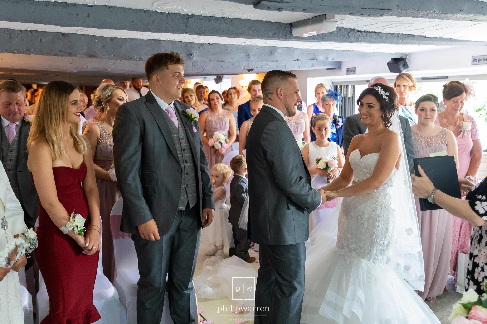bride and groom holding hands at llechwen hall wedding