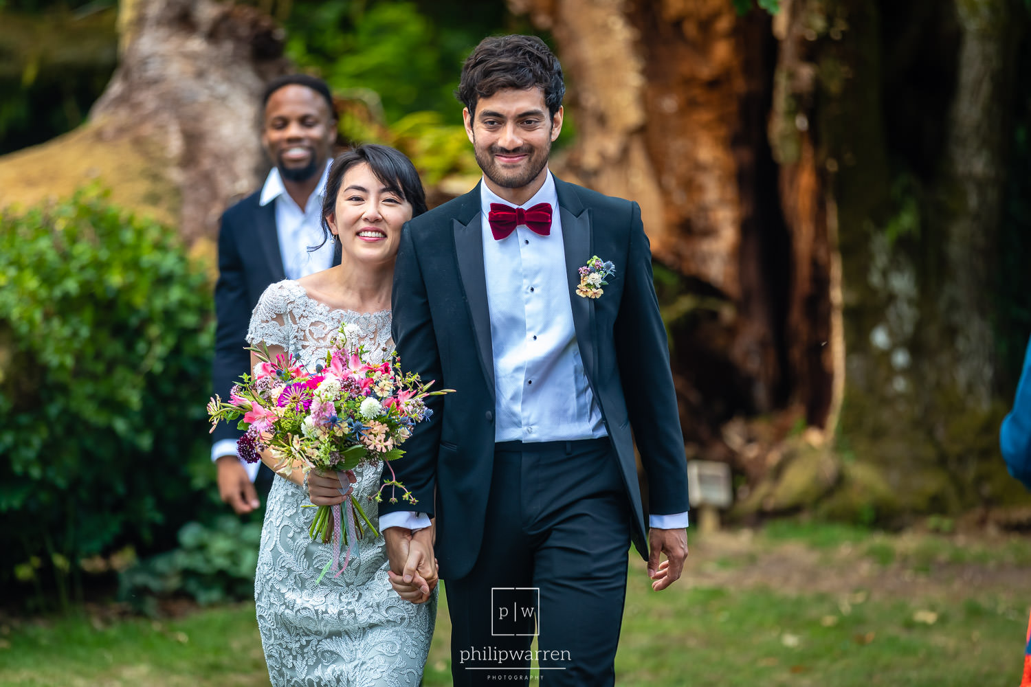just married walking down the aisle outdoors at plas glansevin