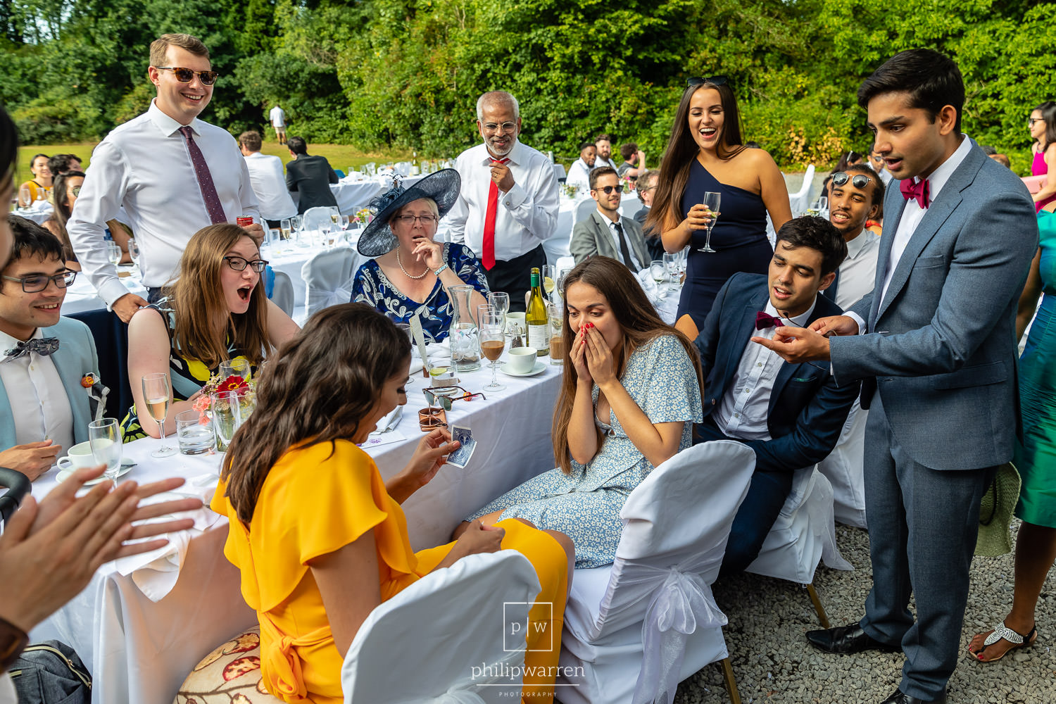 wedding guests at reception amazed by magician