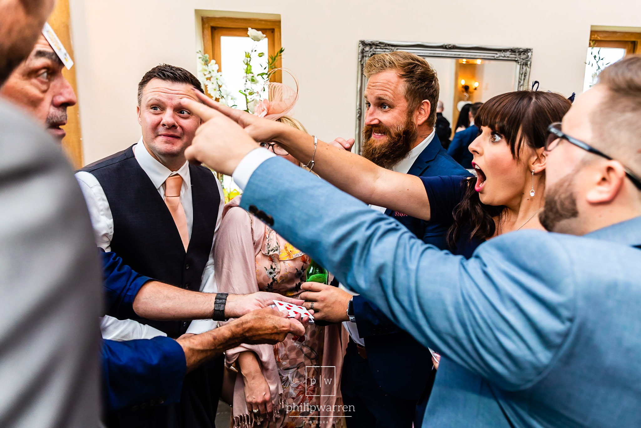 guests amazed at wedding magician tricks