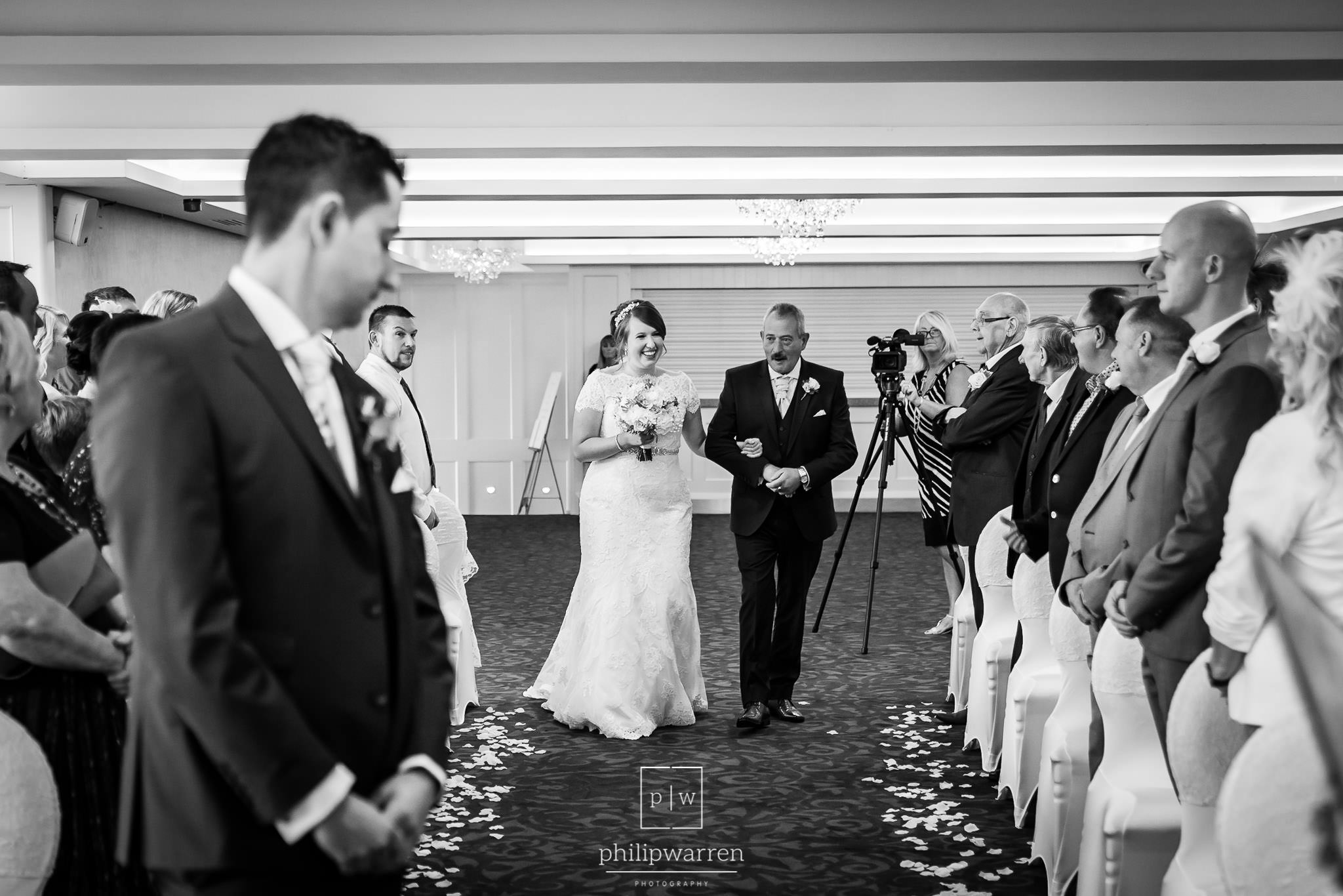 bride and her father walking down the aisle at new house hotel