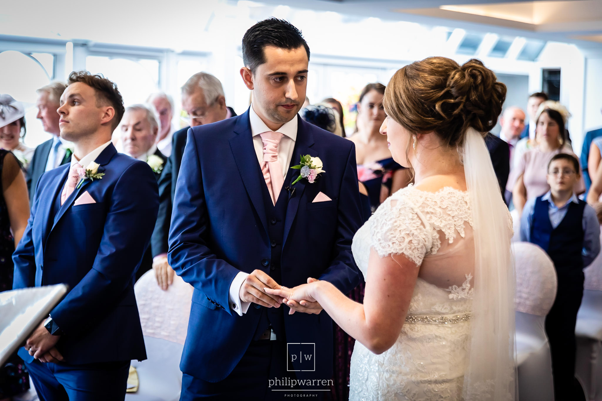 bride and groom holding hands in new house country hotel