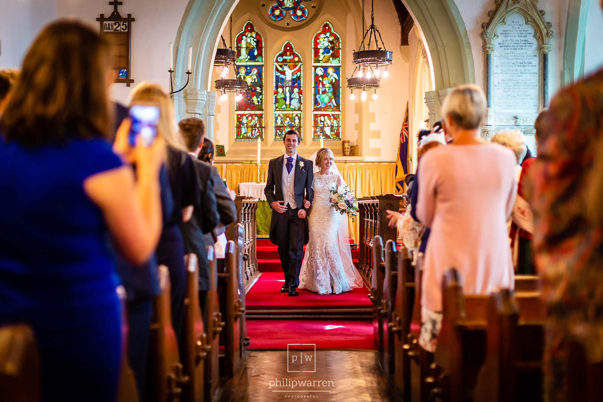 just married walking down the aisle in a church wedding